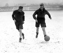 Bradford footballers train in snow, 1930s