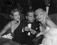 Marilyn Monroe with Humphrey Bogart and Lauren Bacall at Ciro's Nightclub