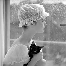 Model with cap and cat